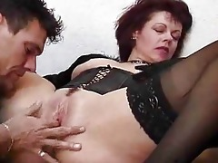 young boy acquires schooled by an mature woman