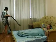 youthful daughter cleaning the room acquires